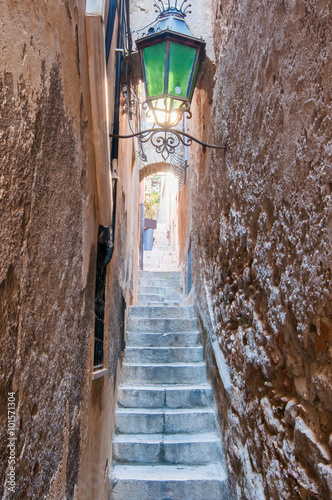Fototapeten Schmale Gasse One typical narrow alley and its staircase in Taormina, Sicily
