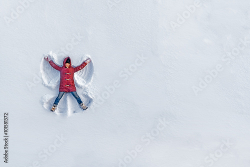 The girl on a snow angel shows