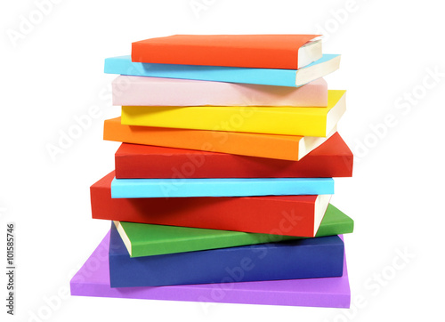 Valokuva  Closeup untidy small pile of paperback books isolated on white background