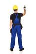 Repairman wearing hard hat pointing up
