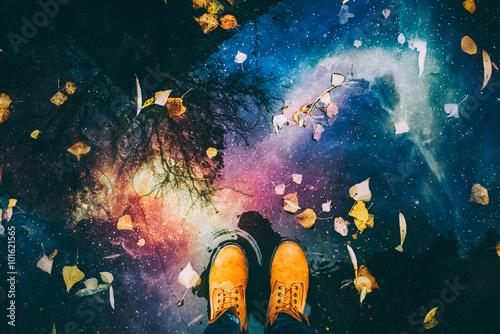 Man's feet and reflection o...