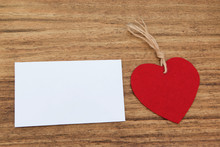 Blank Sticky Note With A Red Heart On A Wooden Background