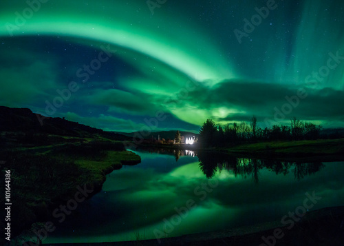 Photo Stands Northern lights Aurora borealis reflecting off a lake