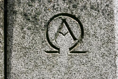 Alpha Omega Symbol Carved In Grey Granite Stone Buy This Stock