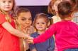 Teacher show little girl pointing finger in group