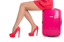 Woman's Legs In Shoes And  Suitcase