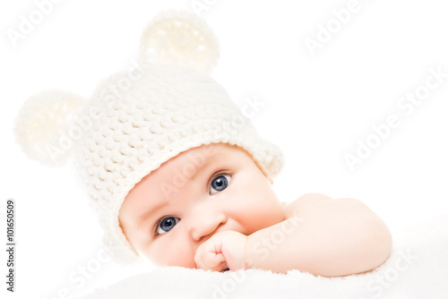 plakat Baby wearing a knit hat with bear ears