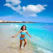 Girl on the beach Fuerteventura at Canary Islands