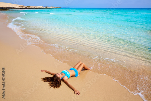 Poster Canary Islands Girl on the beach Fuerteventura at Canary Islands