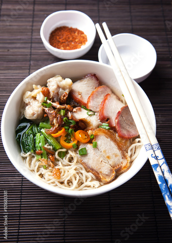 Plagát  noodle with crispy pork and sliced fried pork,thai food