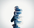 canvas print picture - Portrait of woman holding her smart phone in a hands.  isolated, double exposure