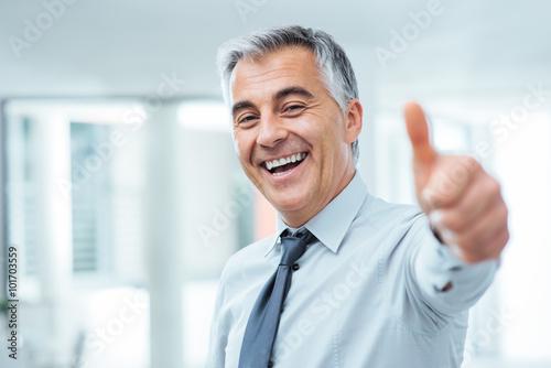 Fotografie, Obraz  Cheerful businessman thumbs up