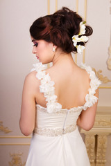 Naklejka Bridal hairstyle with accessories from the back