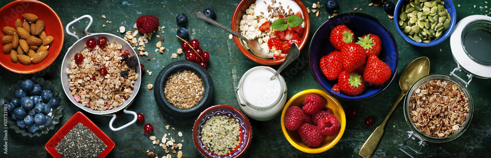 Fototapeta Healthy breakfast of muesli, berries with yogurt and seeds