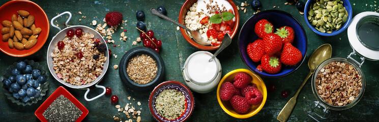 Fototapeta Vintage Healthy breakfast of muesli, berries with yogurt and seeds