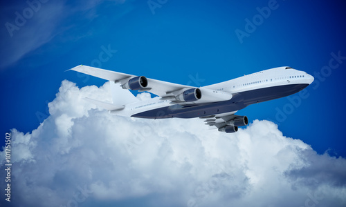 Fotografia  White plane flying in sky and clouds. Airplane boeing 747