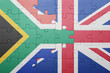 canvas print picture - puzzle with the national flag of great britain and south africa