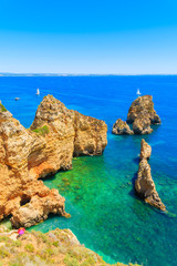 FototapetaCliff rocks and sea bay with turquoise water at Ponta da Piedade, Algarve region, Portugal