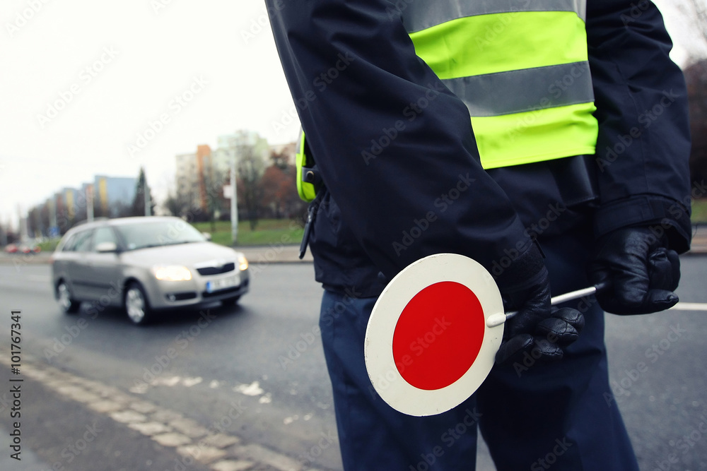 Fototapeta A police man checking the traffic.