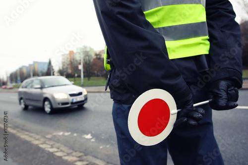 Fotografie, Obraz  A police man checking the traffic.