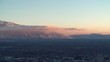 The Wasatch mountain range over looks the Salt Lake City valley at sunset.