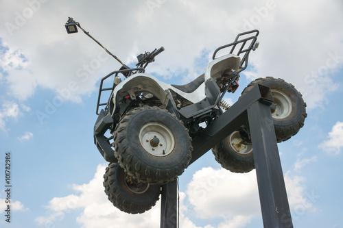 ATV Quad Bike on stand with blue sky background
