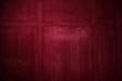 Ungleichmäßig gefärbte rote Steinwand