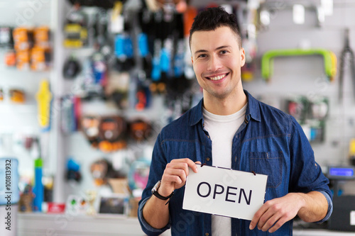 Poster Positive Typography Man in bike shop holding open sign