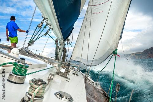 Staande foto Zeilen Man on thr yacht during storm.