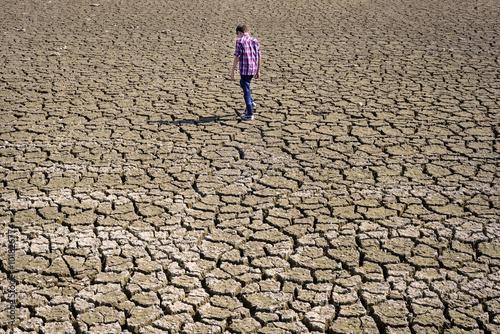 child walking on dry land Poster