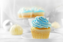 Tasty Blue Cupcake With Candle...