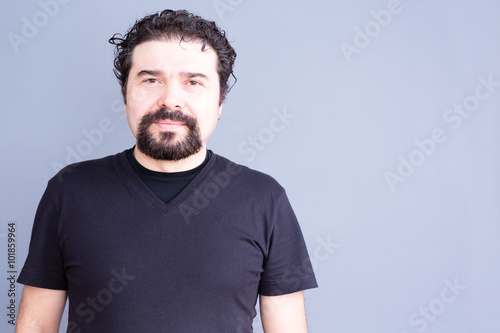 Fotografie, Obraz  Man with Beard and Curly Hair Wearing Dark T-Shirt