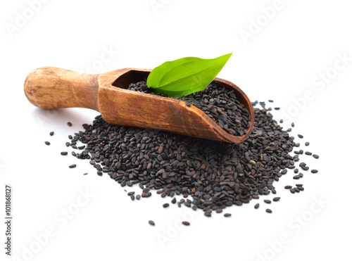 Black sesame seeds. Isolated on white background.