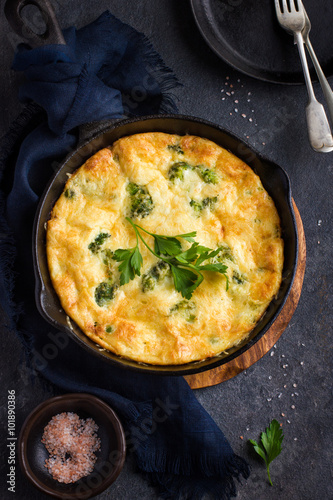 frittata (omelette) with vegetables and cheese in cast iron pan