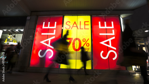 Sale signs in shop window, big reductions #101891901