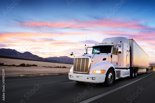 Obraz na plátne Truck and highway at sunset - transportation background
