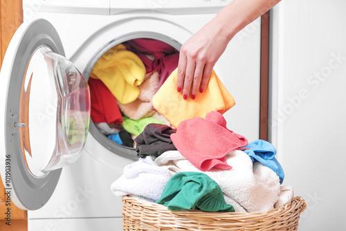 Fotografie, Obraz  Woman and a washing machine.