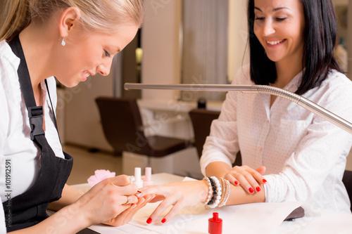Happy women doing manicure