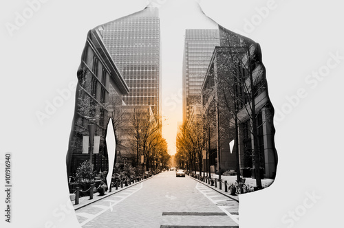 Fotografie, Obraz  Double exposure of businessman in suit and cityscape