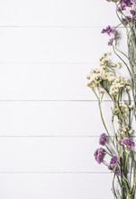 Bouquet Of Dried Wild Flowers On A White Background Of Vintage Wooden Planks Top View Vertical