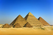 Egypt. Cairo - Giza. General view of pyramids from the Giza Plateau (on front side: 3 pyramids popularly known as Queens' Pyramids; next: the Pyramid of Mykerinos, Chephren and Cheops)
