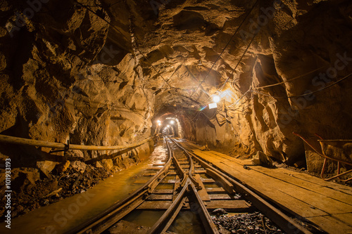 Valokuva  Gold mine underground ore tunnel with rails