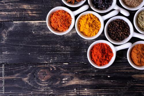 Foto op Canvas Kruiden Spices in ceramic bowls