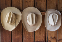 Cowboy Hats Hanging From Pegs ...