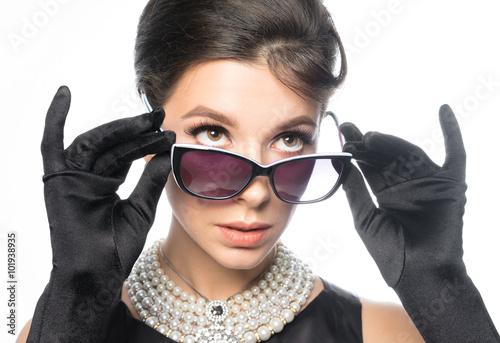 Photo  Retro Girl - looks, wears glasses