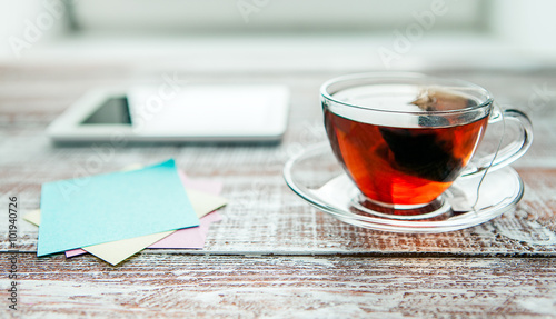 Staande foto Thee red tea with a tablet on a table in an office