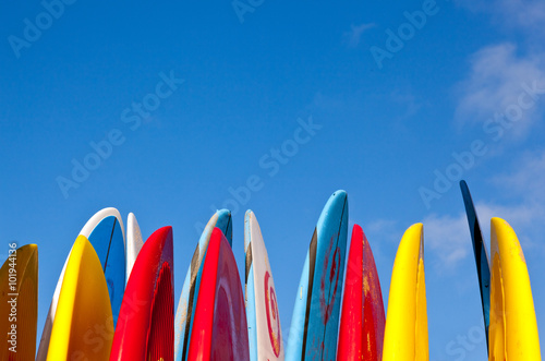 Fotografie, Obraz  Stack of surfboards with sand on surface