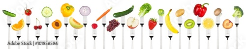 row-of-tasty-fruits-and-vegetables-on-forks-isolated-on-white-background