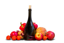 Group Of Ripe Red And Orange Fruits And Vegetables With Bottle