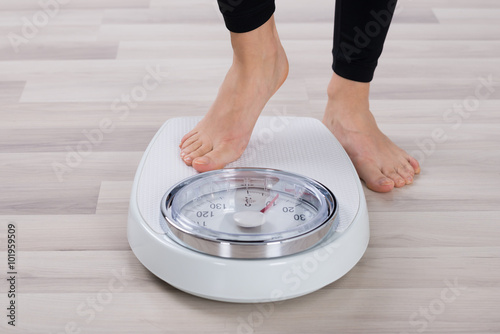 Fototapeta  Person Standing On Weighing Scale